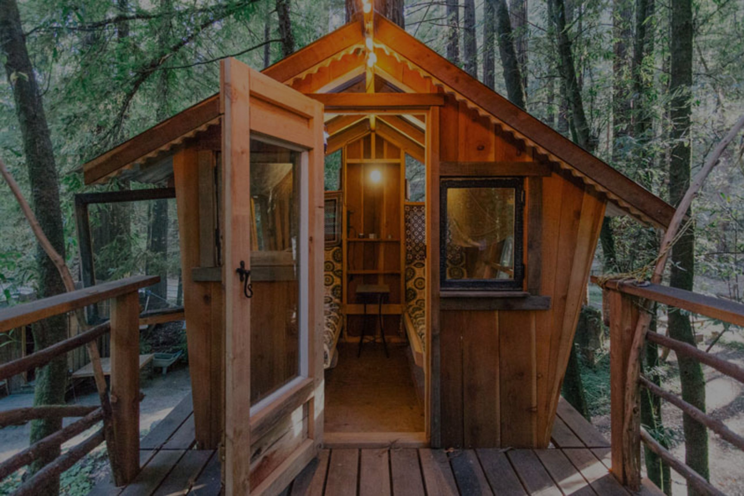 Mountain Bliss: A Creekside Cabin, Rustic Treehouse & Outdoor Canopy Bed