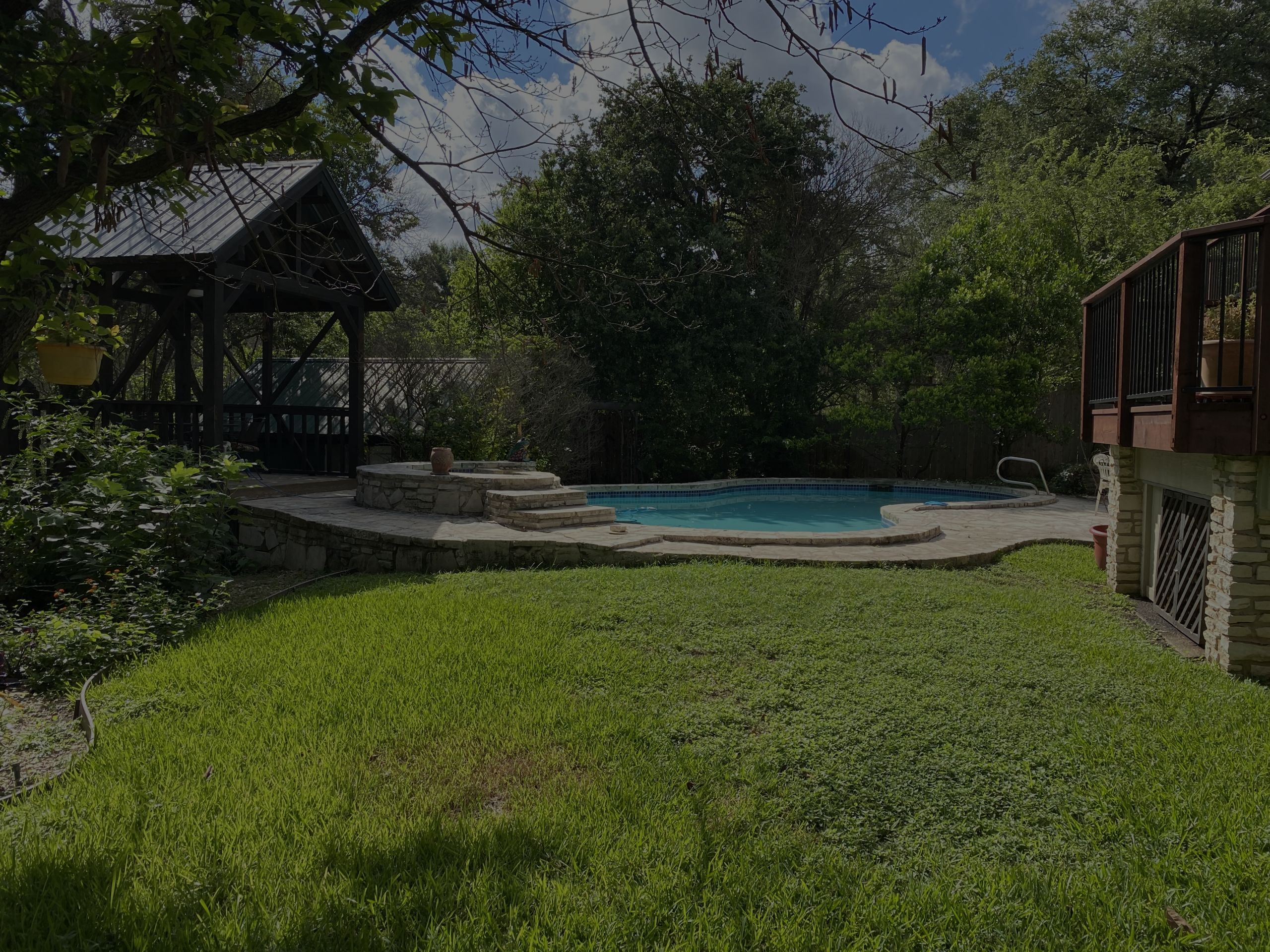 This outdoor space has everything one could want. Pool, yard, garden, gazebo and separate office.