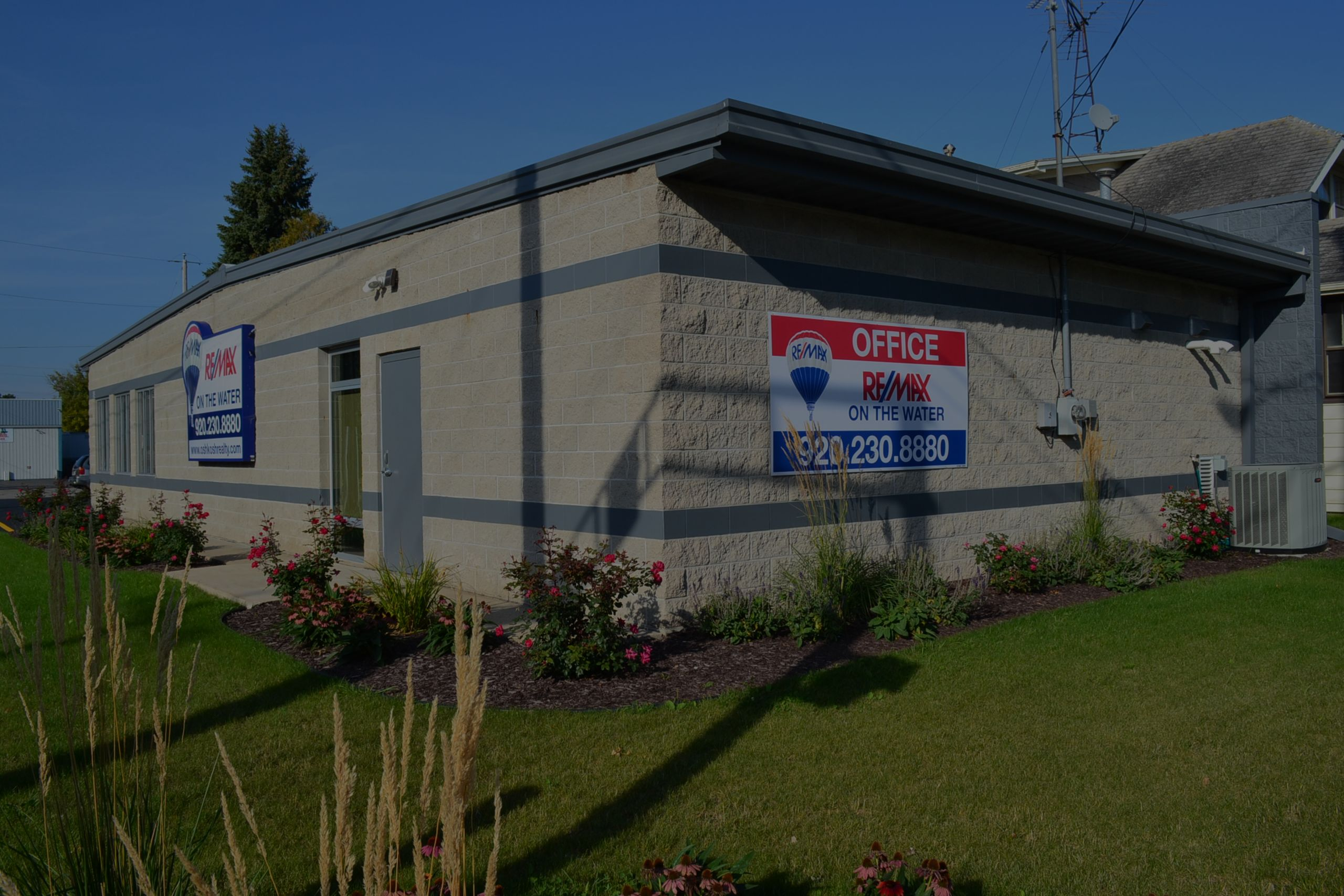 RE/MAX On The Water Office- Corner of 9th & Knapp St, Oshkosh, WI
