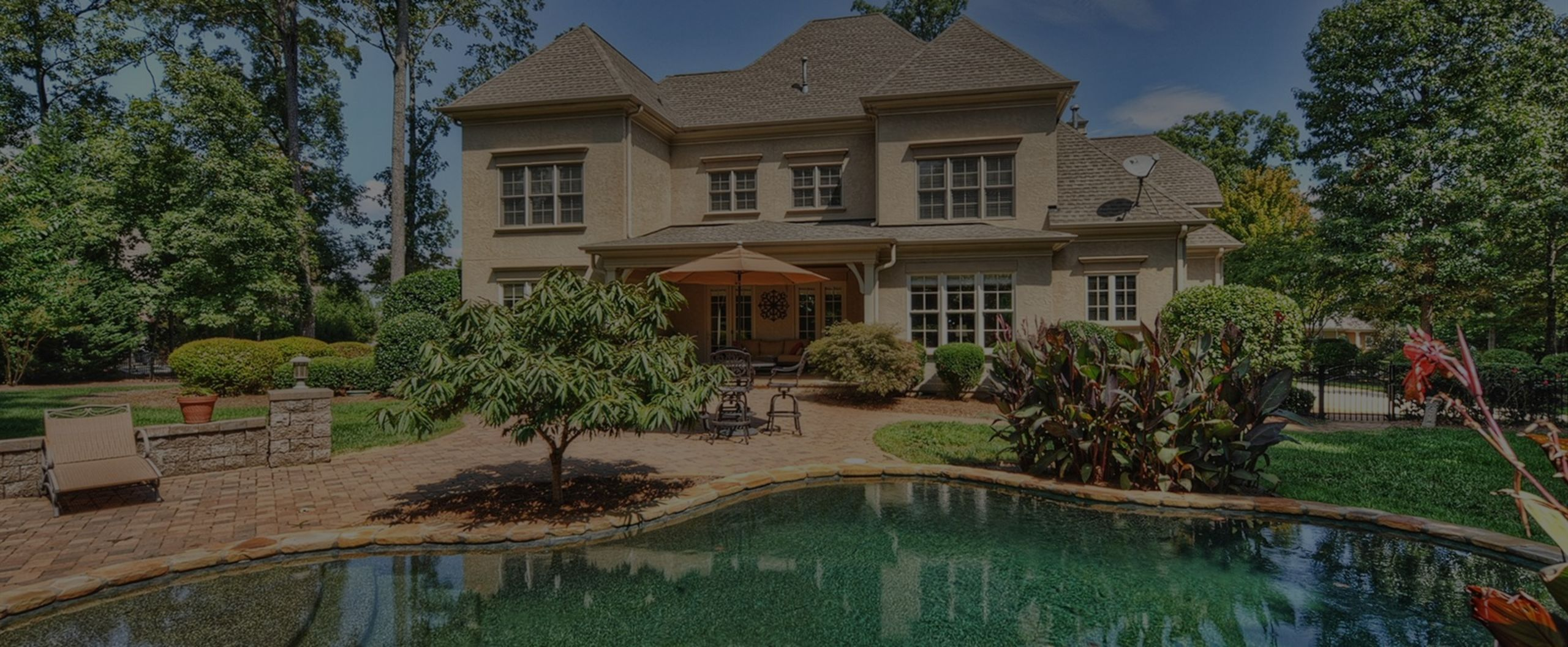 Relax and enjoy this backyard oasis near near Lake Norman.
