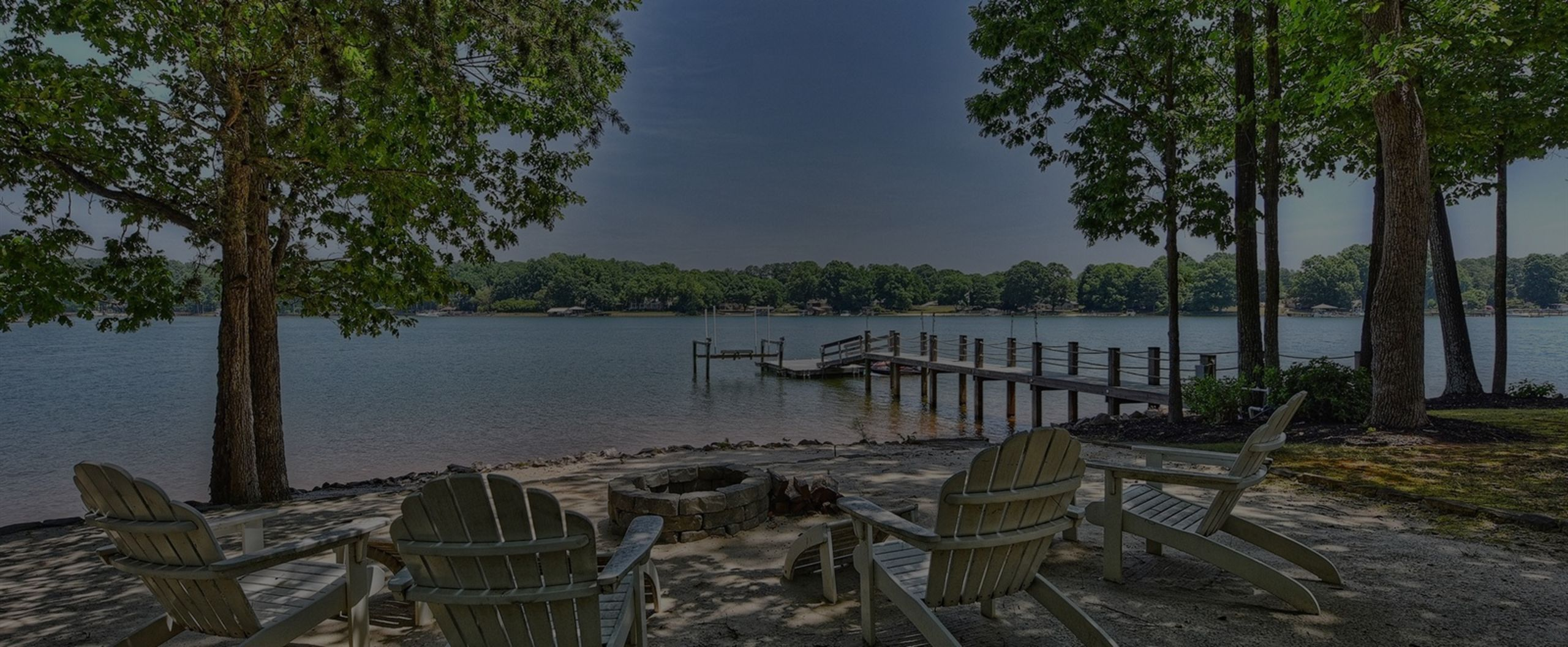 A private beach is just one amenity of this stunning lakeside home.
