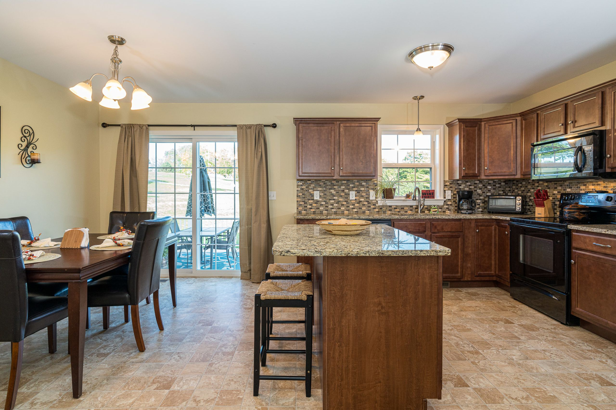 Open layout kitchen with granite counter tops