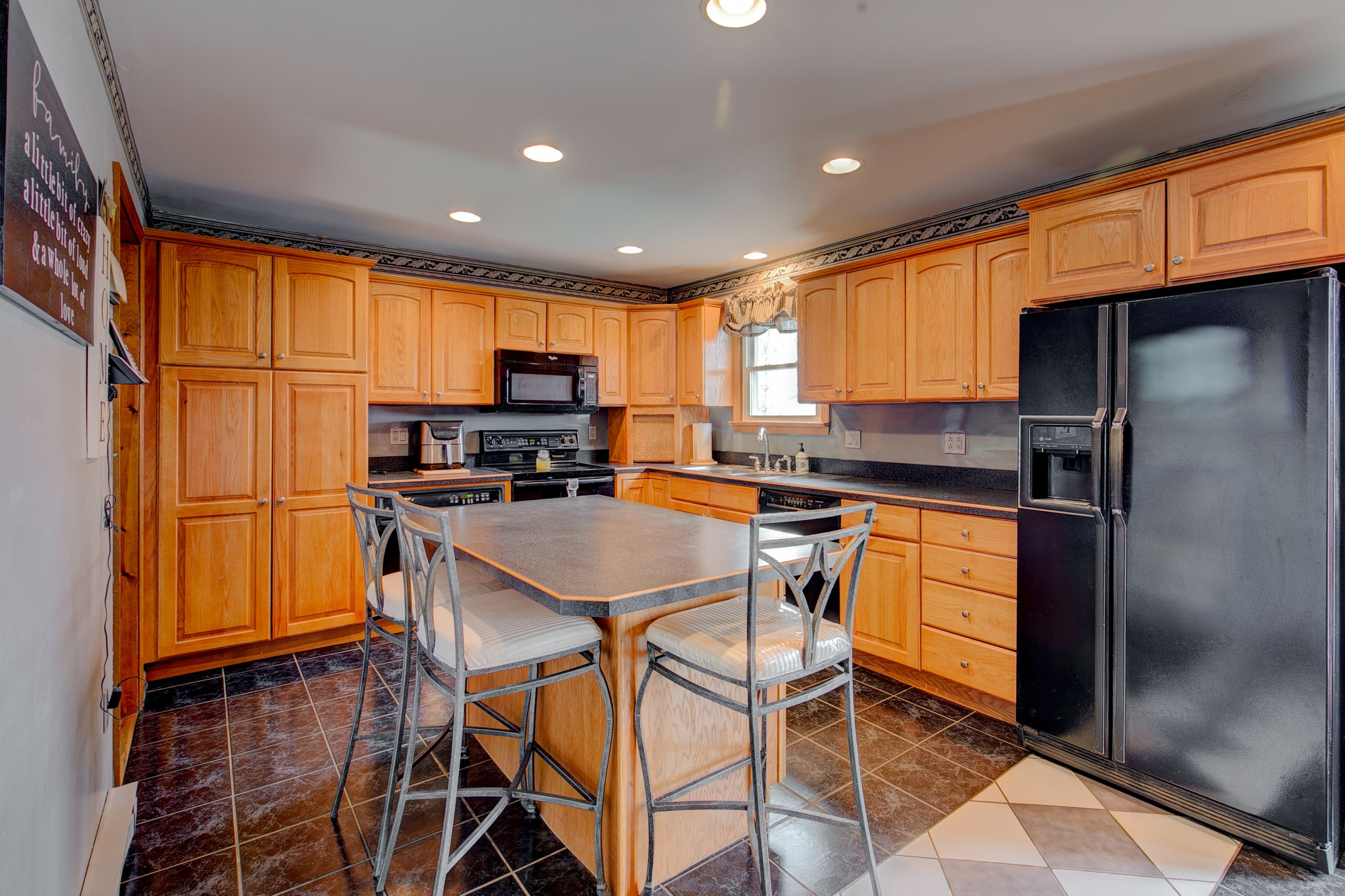 Open layout kitchen with island and barstools