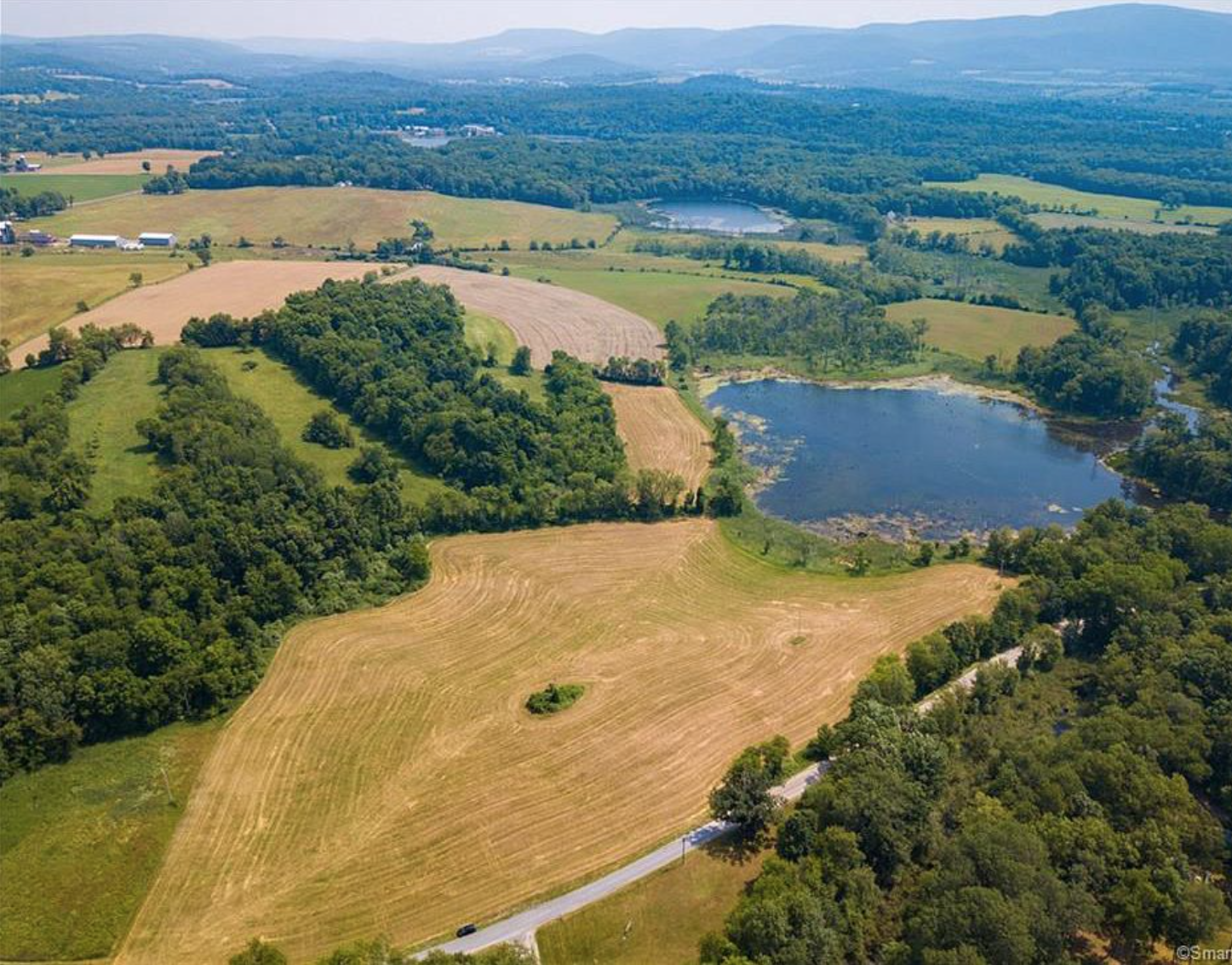 FEATURED LISTING: 44+ Acres with Mountain, Pastoral and Water Views $395,000
