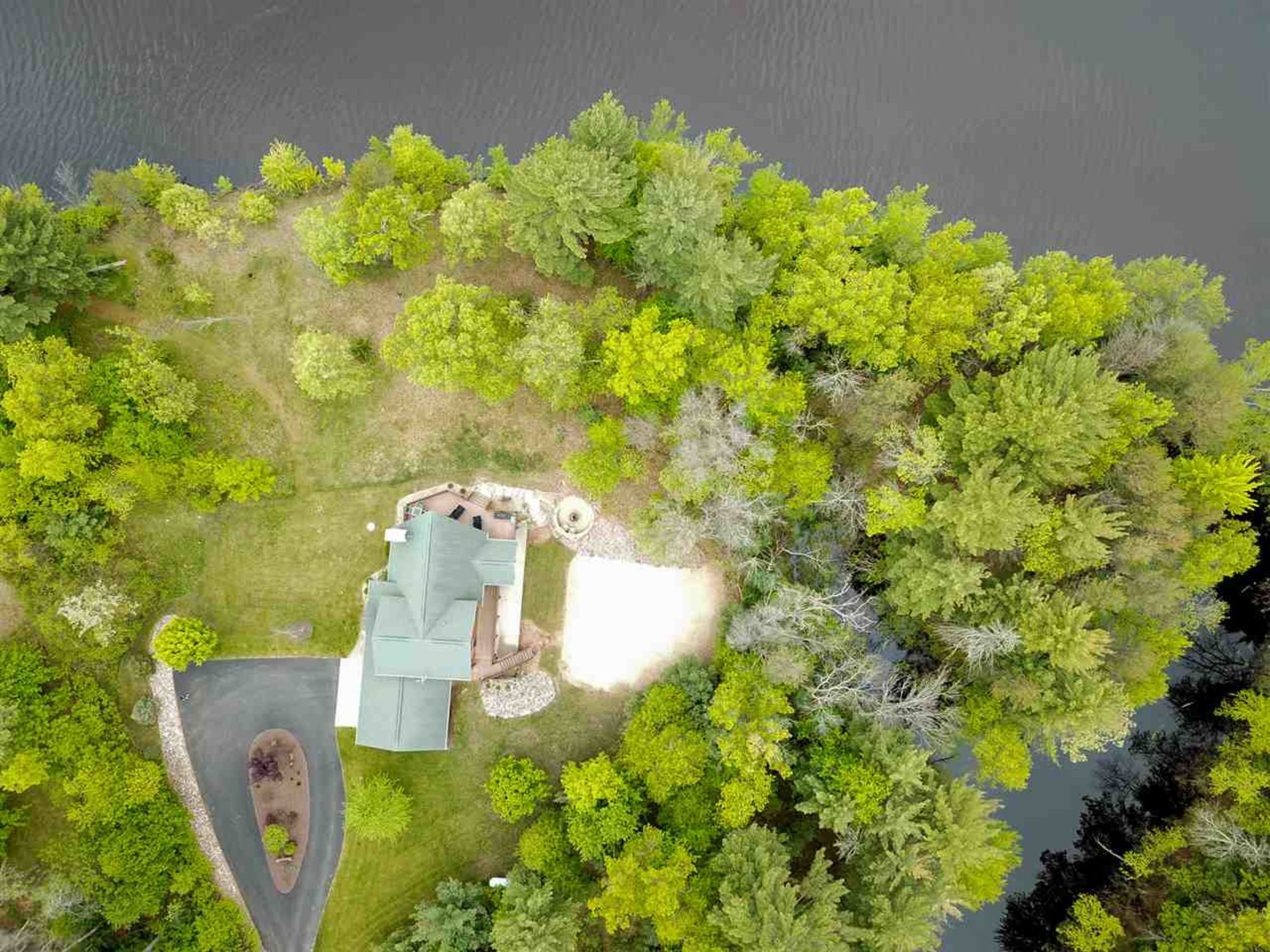 Beautiful Log Home Offering 279' of Frontage on Castle Rock Lake