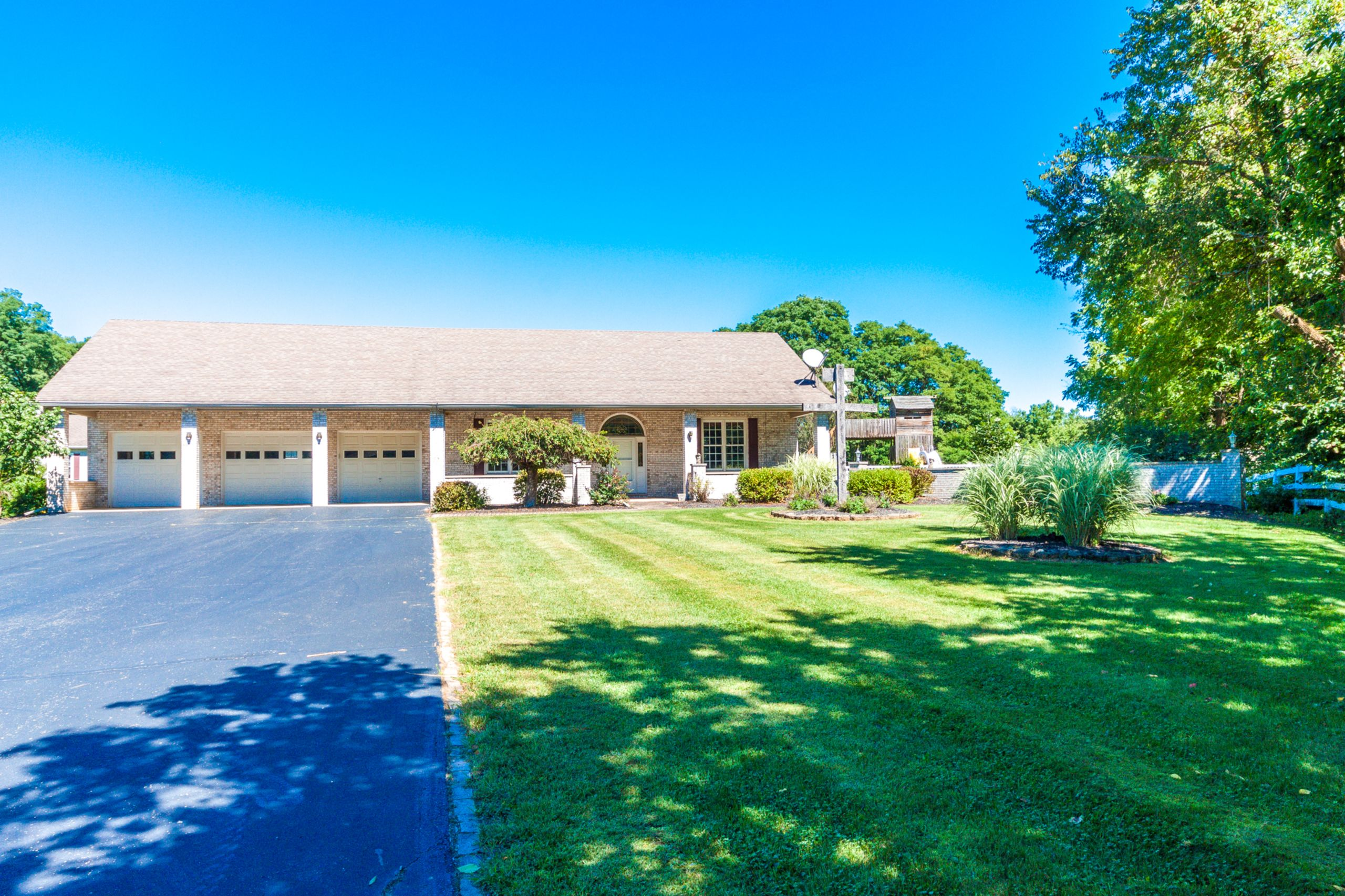 Stunning full brick ranch style home situated in an excellent area on just over 2 scenic acres