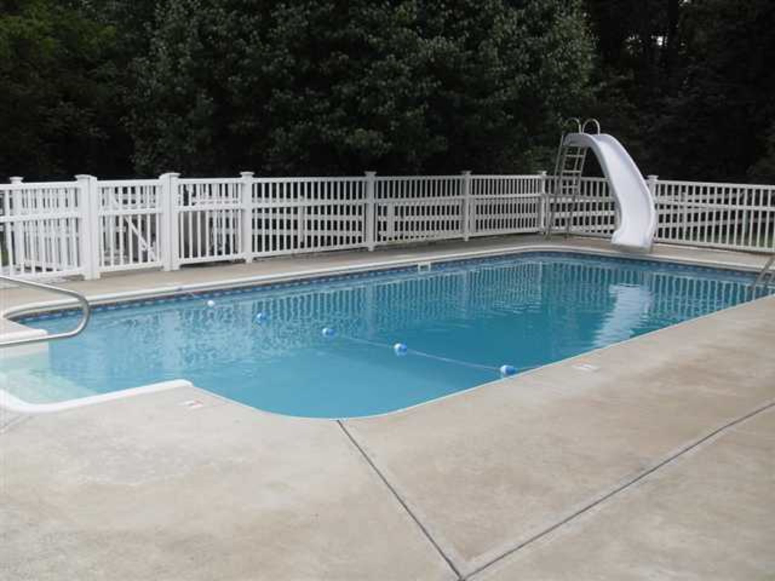 Heated in-ground pool w/slide and new electric cover