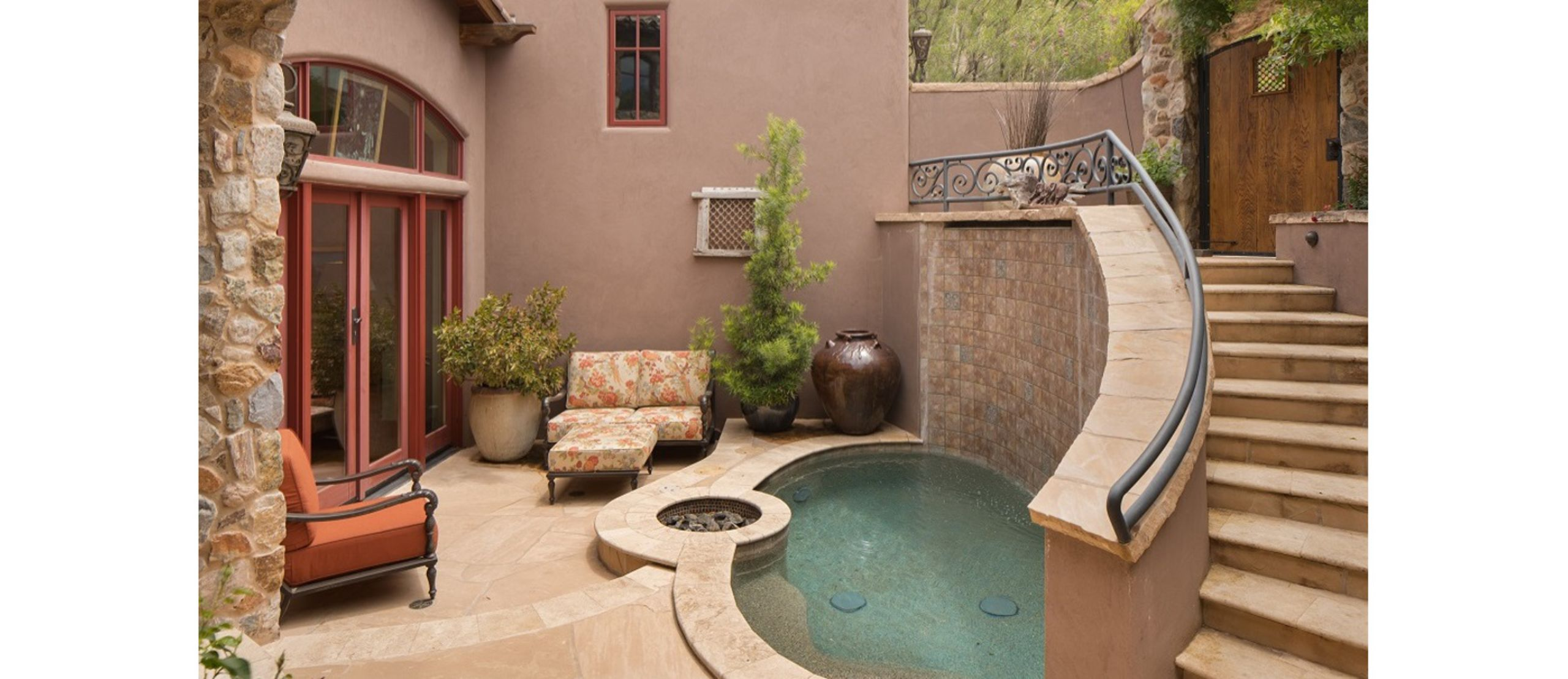 Sunken courtyard with spool for tranquil, private, space