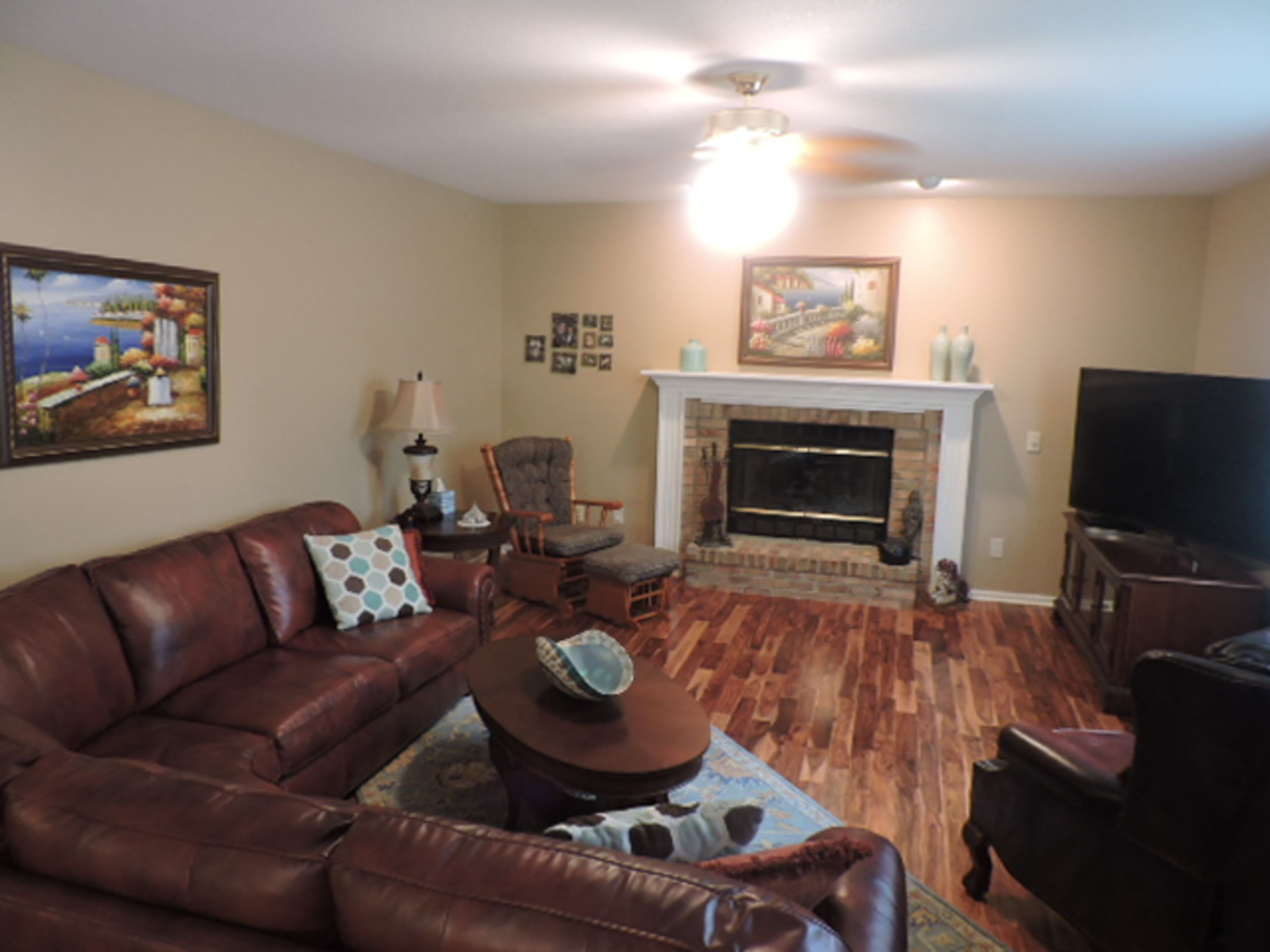 FAMILY ROOM WITH NEWER WOOD PLANK FLOORING