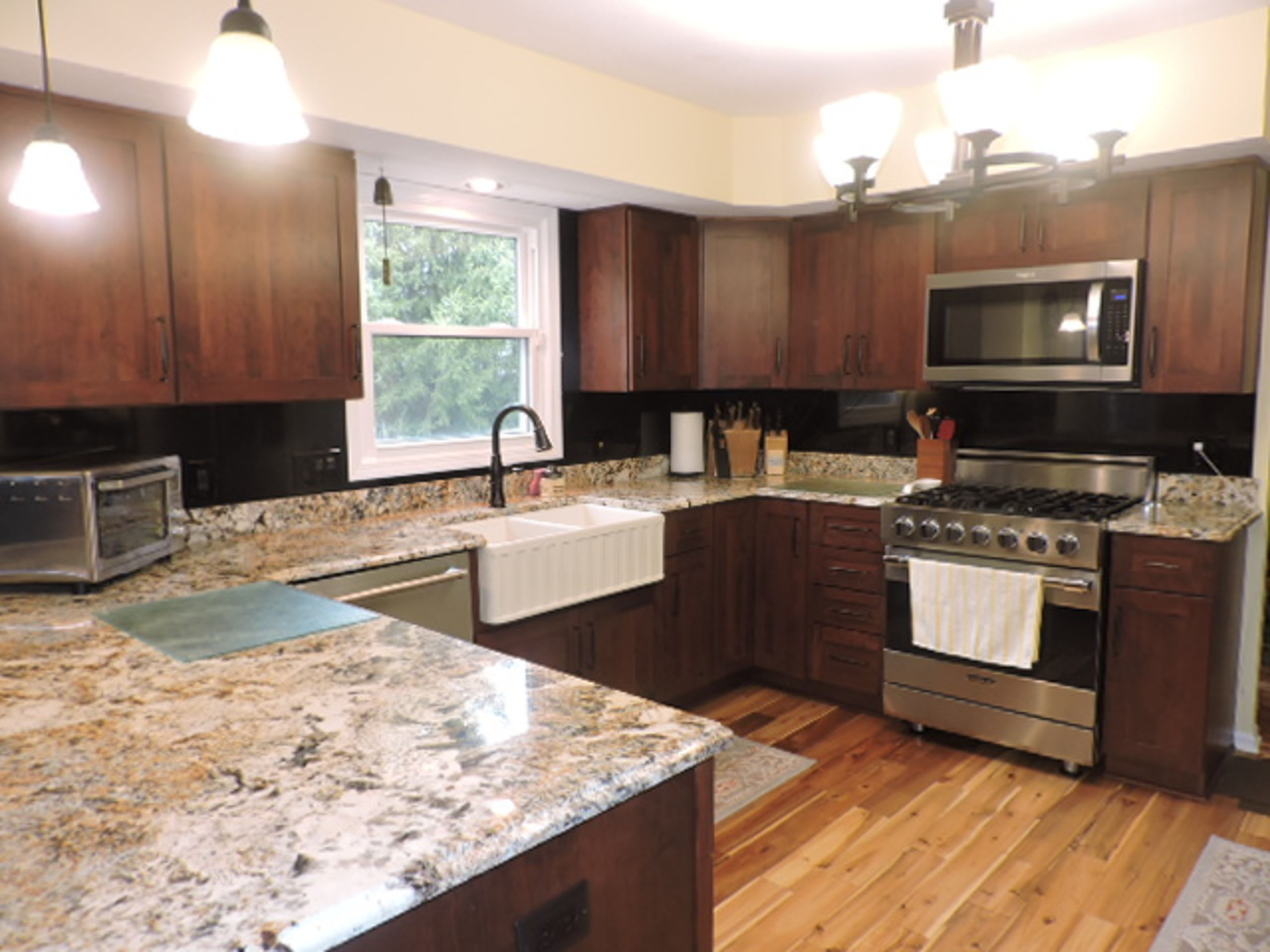 NEW CUSTOM KITCHEN OPENS TO THE FAMILY ROOM
