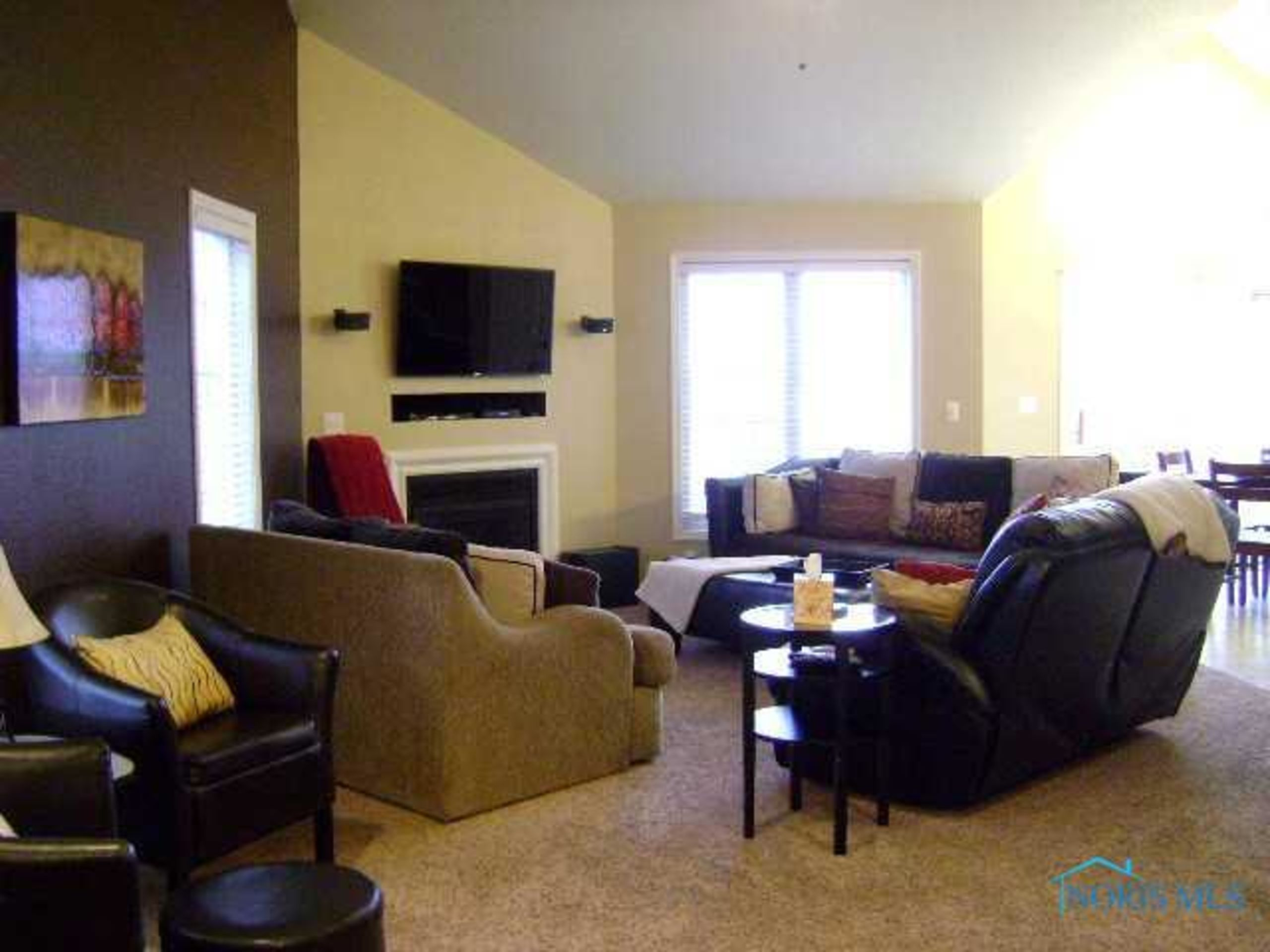 Open Family Room With Vaulted Ceiling & Fireplace