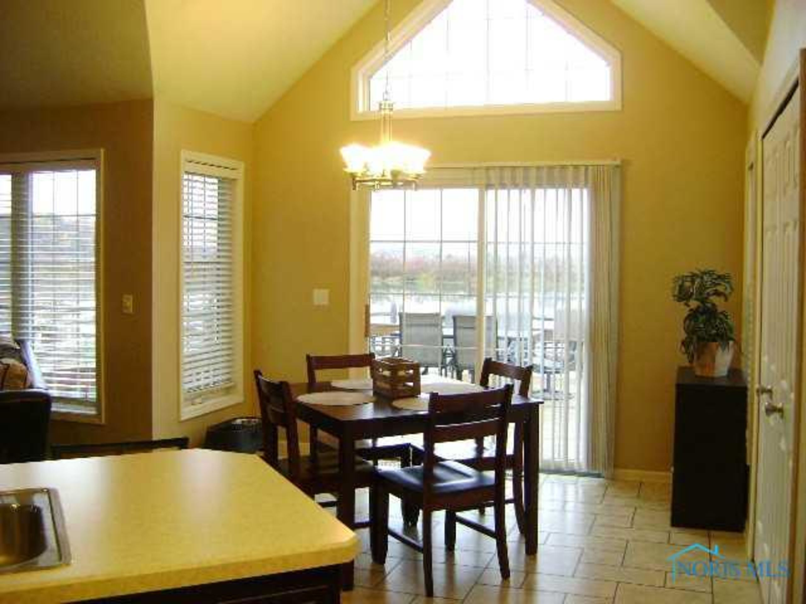 Dinette With Cathedral Ceiling & Tile Flooring