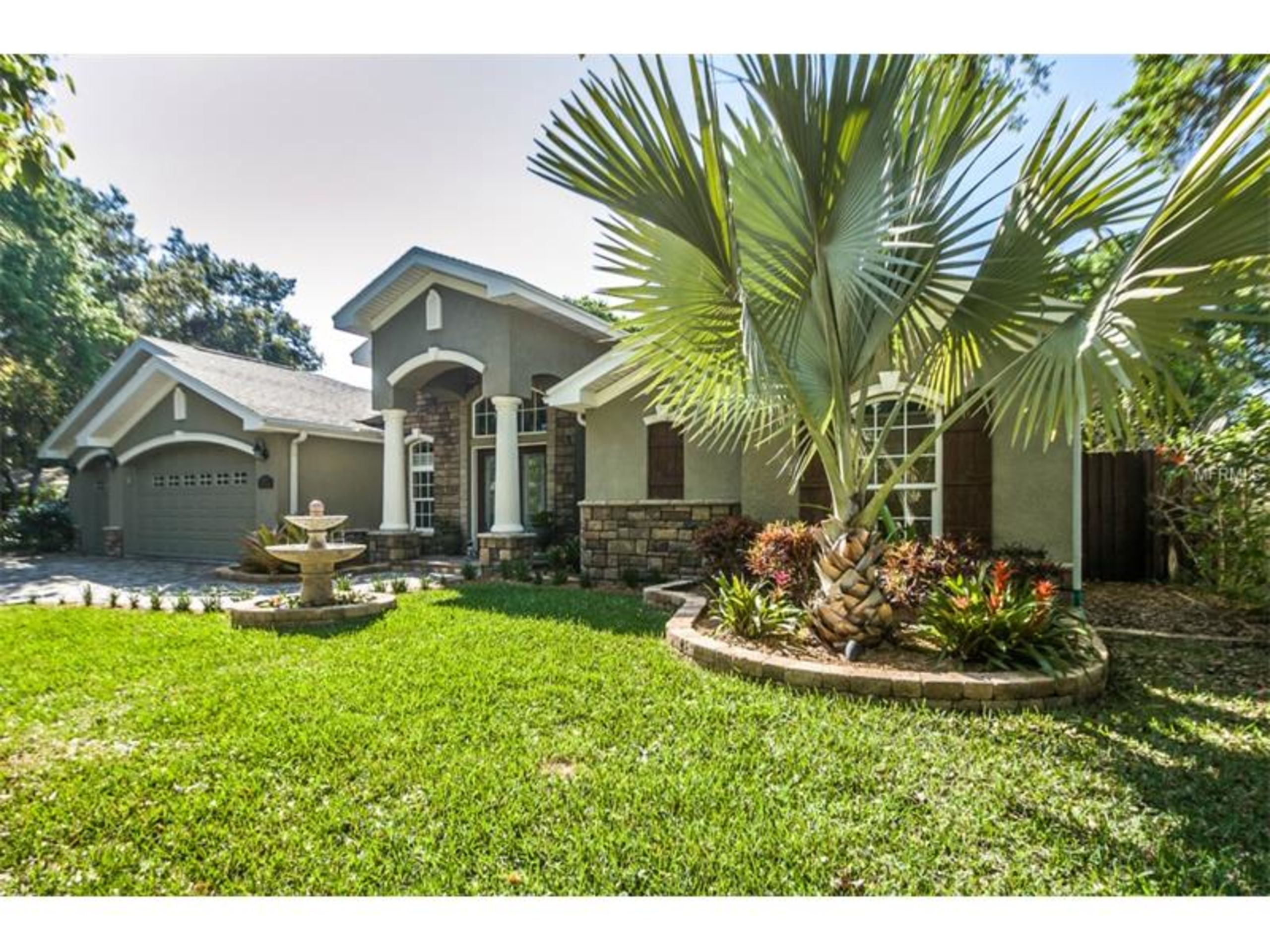 Custom built home on a tree-lined street in OAK FOREST, Seminole, FL