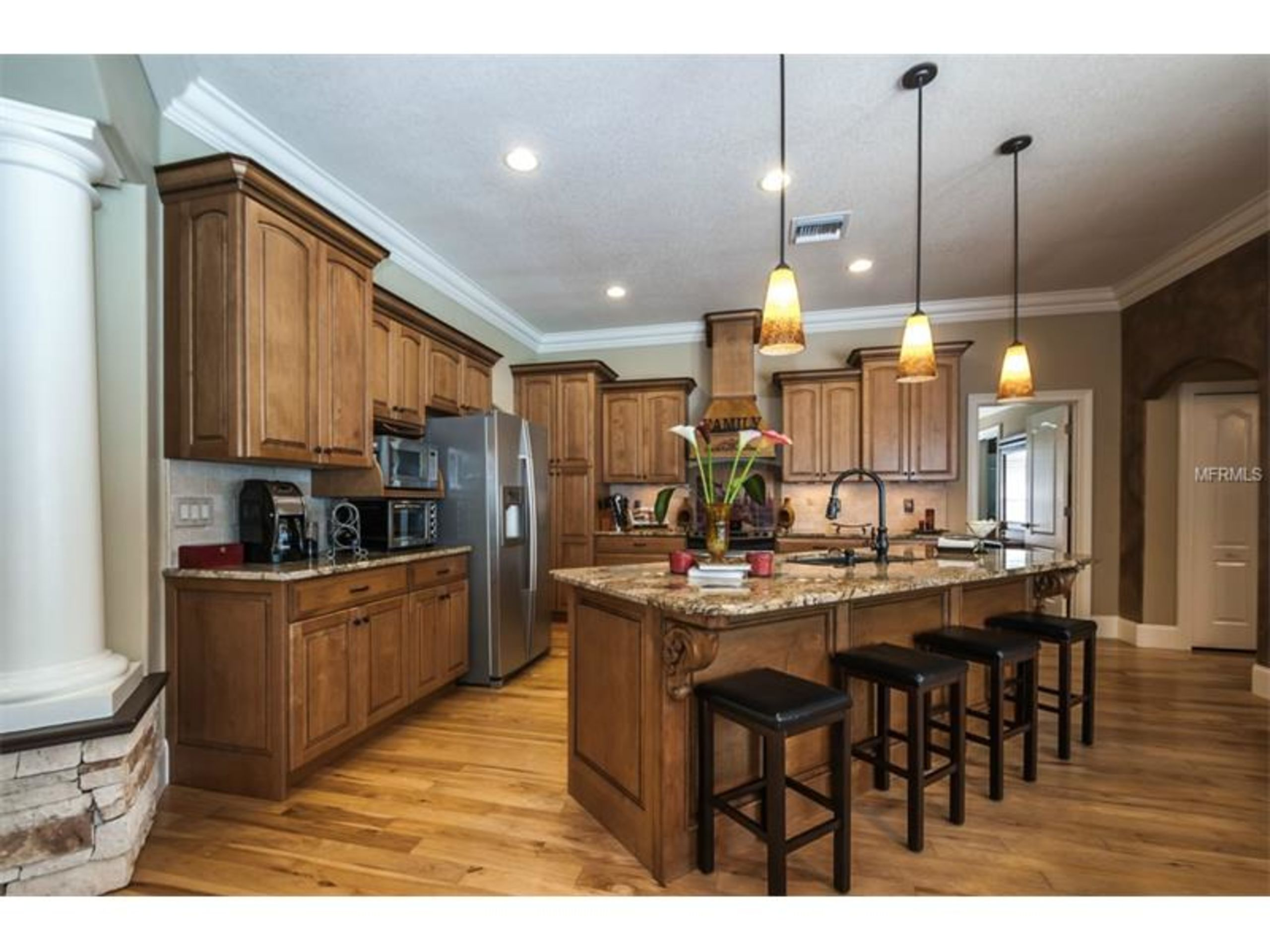 Custom Kitchen with Solid Wood Cabinets, Crown Molding, Granite Countertops over a sprawling Island with a Black Granite Under Mount Sink!