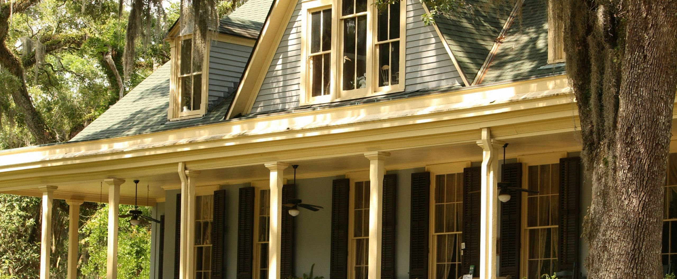 Wraparound porches and dormered roofs