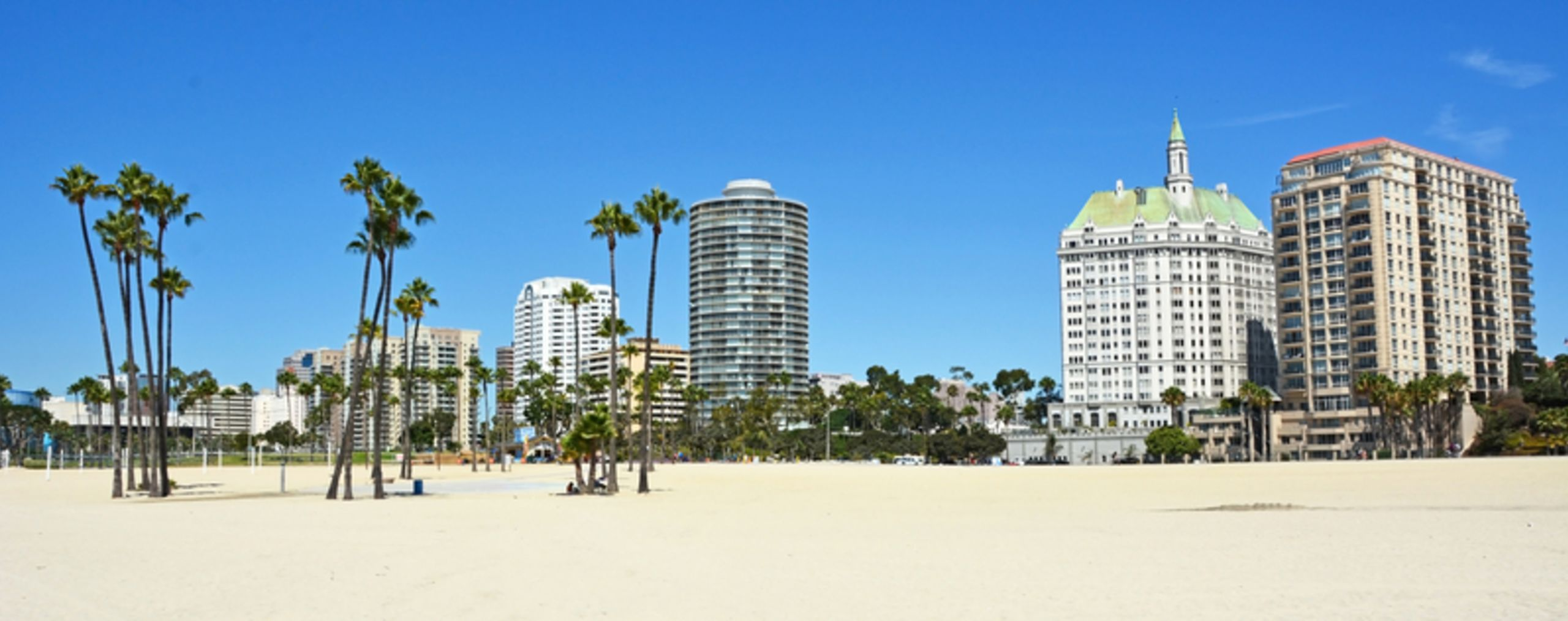 Condos along the beach by Dreamstime.