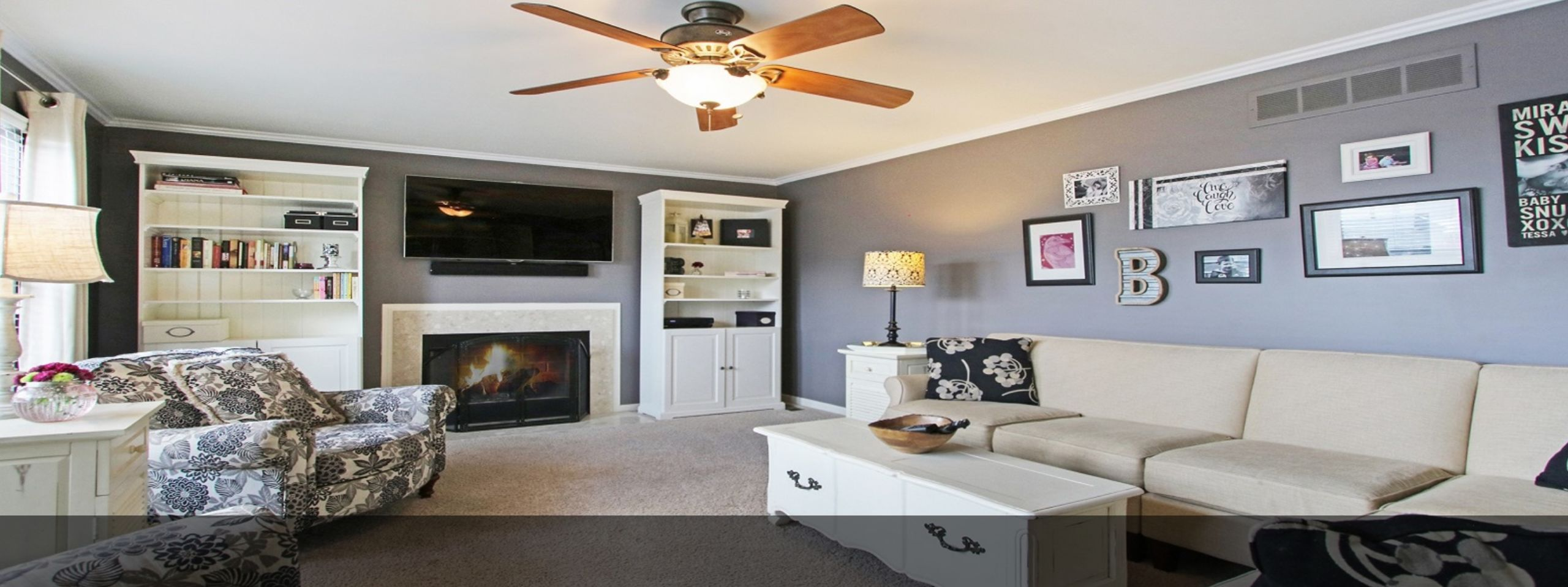 Cozy family room w.open site-line to kitchen, gas fireplace for the chilly autumn nights & plenty of room to gather.