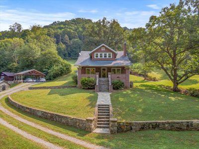 Idyllic Brick Farmhouse on 133 Acres in Mars Hill