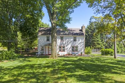 Charm & Character Abounds In This Delightful Trappe Borough Home On Almost 2 Acres With Public Water & Sewer!