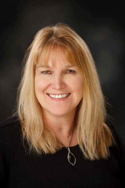 Debra Kluck-Oksiuta <div> Broker – Owner, Realtor, GRI, CRS, ABR <div />
