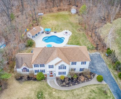 Newly Listed For Sale!  Cul-de-sac Atkinson Colonial w/ IG Pool!