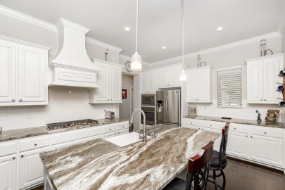 Abundance of quality finishes in this home in Central!