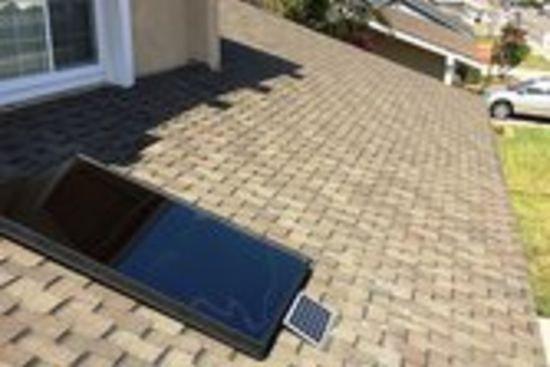 Solar air heater installed on roof of suburban home A Solar Air Heater Can Save You $300 a Year or More