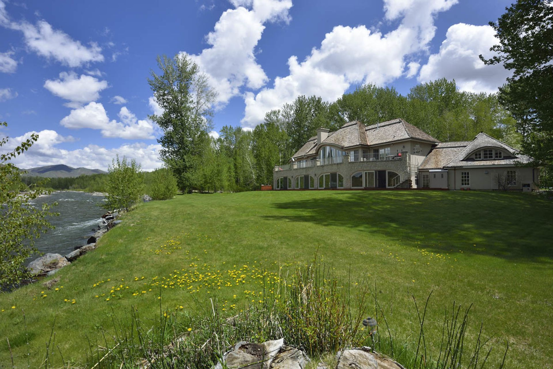 Gorgeous 5 Acre River Front Property in Deer Creek!