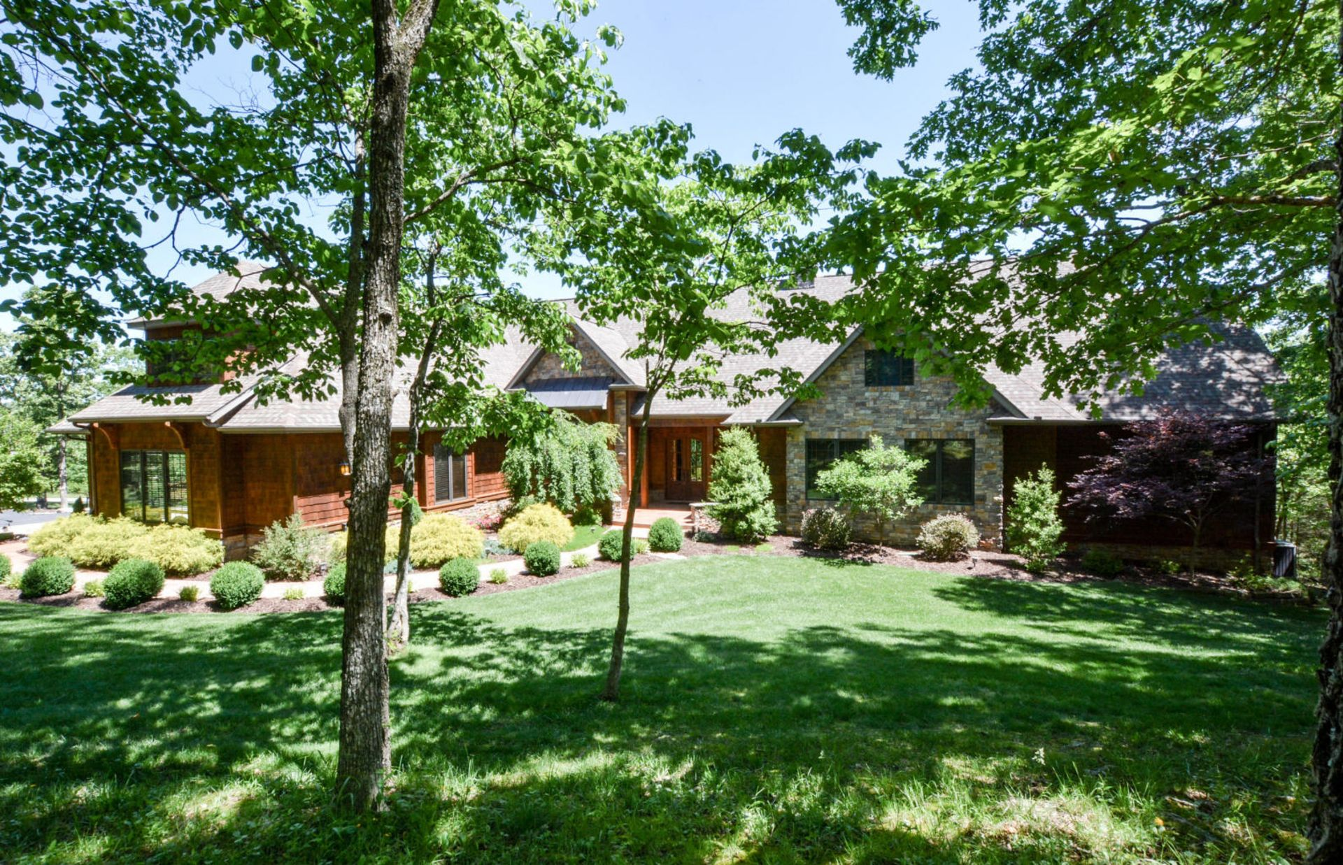 This Saddlebrooke, MO home is just 30 Minutes South of Springfield in a Wooded Setting!!!