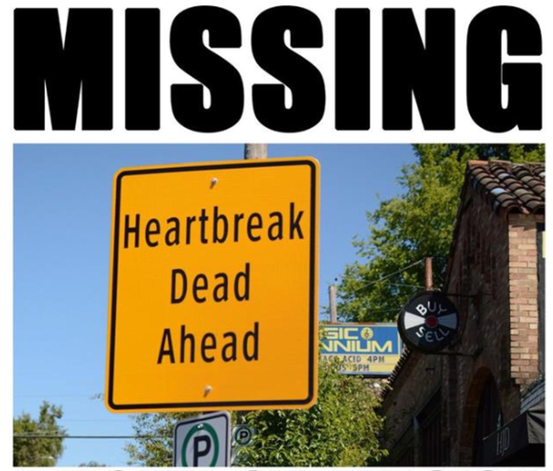 """Music Millennium's """"Heartbreak Dead Ahead"""" Street Sign Has Gone Missing"""