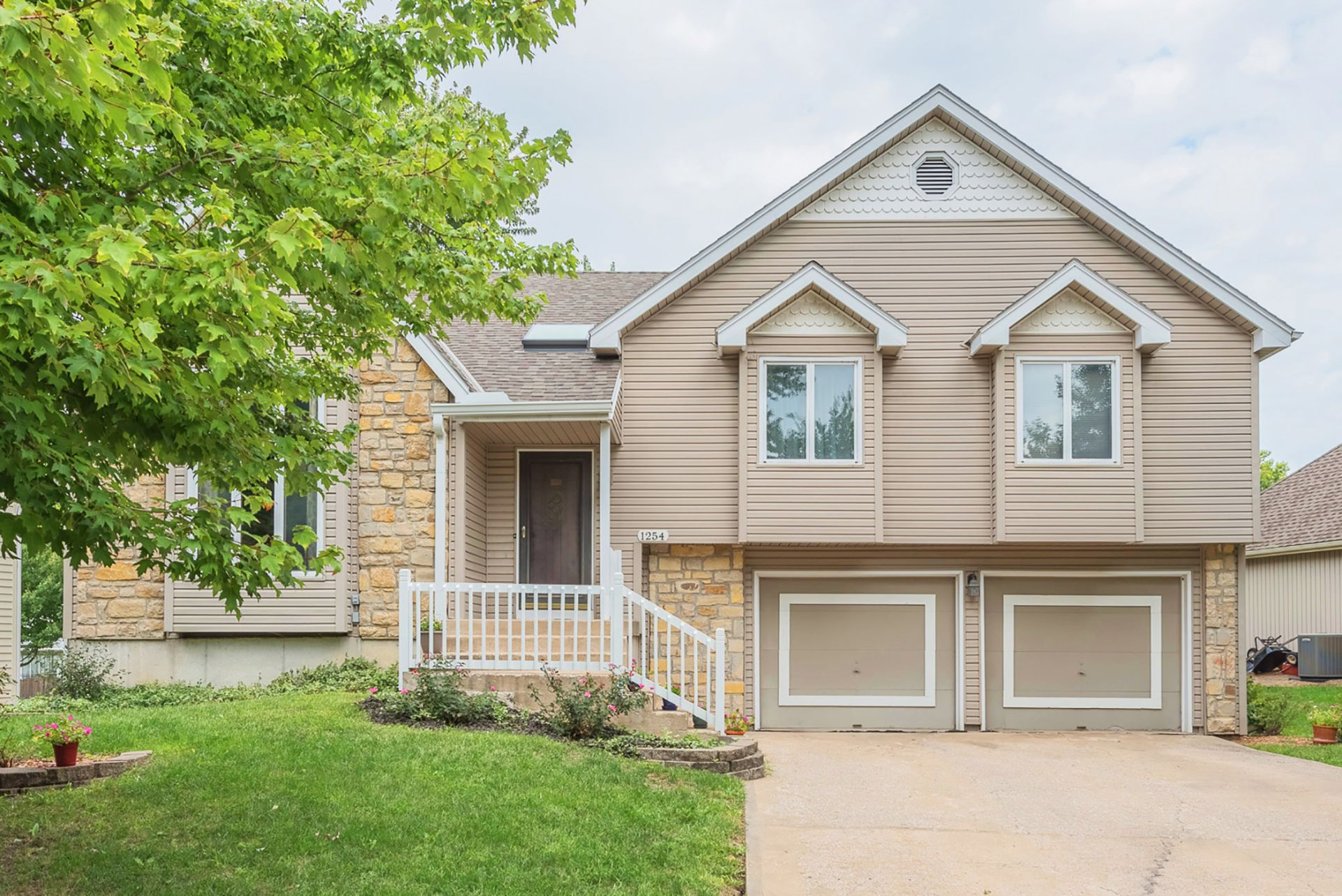 NEW ON THE MARKET in Olathe with First OPEN HOUSE!