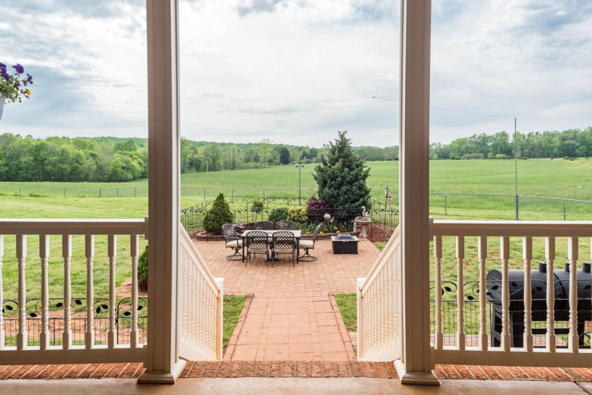 Stunning 25 acre property with wonderful landscaping and large barn with workshop