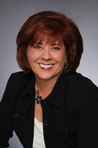 Catherine Corbett, <br> Principal Broker