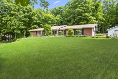 Just Listed: Pristine 4BR, 3BA Ranch on Almost 2 Wooded Acres on Geneva Lake's South Shore | W4511 Basswood Dr, Lake Geneva WI