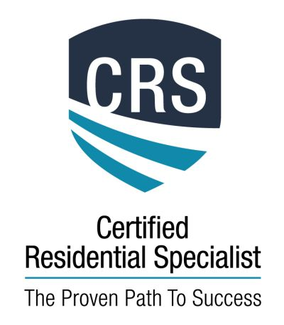 Why is it important to work with a real estate agent who has the CRS designation?