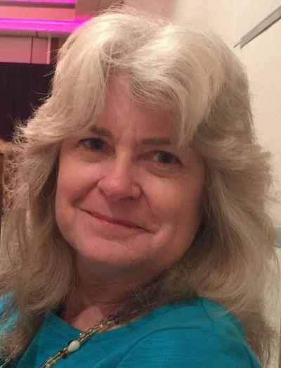 Christine L Spooner